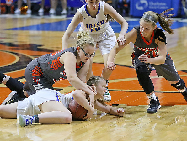 (Brad Davis/The Register-Herald) Summers County players Chloey Davis, left, and Tiffani Cline dive for a loose ball with St. Joseph Central's Paige Shy defends Friday night at the Charleston Civic Center.