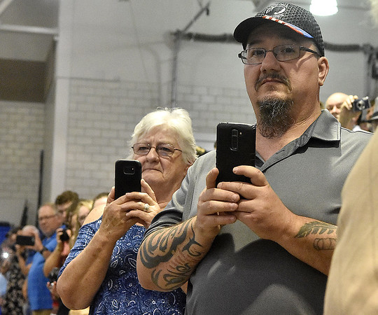(Brad Davis/The Register-Herald) Family members snap photos as graduating Nicholas County seniors make their way into the Summersville Armory and Convention Center during the school's commencement ceremony Sunday afternoon.