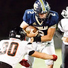 Jared Sagraves of Nicholas County tries to make his way down field but is stopped by Oak Hill's Hunter Perdue. Chad Foreman for the Register-Herald.