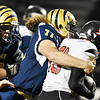 Shady Spring's Terymykal Alexander (77) tackles Liberty's Logan Dodrill (13) <br /> during their high school football game Friday in Shady Spring. (Chris Jackson/The Register-Herald)
