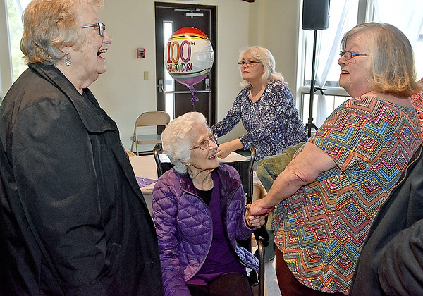 (Brad Davis/The Register-Herald) Ghent resident Florence Mandakunis, middle, shares a laugh with friends Margaret Treola, left, and granddaughter-in-law Gwen Spinella, far right, during the opening moments of her 100th birthday party Saturday afternoon at Calvary Assembly of God.