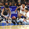 Woodrow Wilson against Martinsburg during the quarter-final game of the Class AAA Boys State Basketball Tournament held at the Charleston Civic Center. Martingburg won 58-48<br /> (Rick Barbero/The Register-Herald)