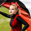 An Oak Hill Flag Corps member twirls her school's colors. Chad Foreman for the Register-Herald.