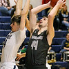(Brad Davis/The Register-Herald) Westside's Corey Hatfield drives to the basket as Shady Spring's Ryan Riffe defends Wednesday night in Shady Spring.