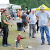 "Lee Mysliwiec, from Bloomington, Ind., plays fiddle with his puppets, ""Harry the Haire"" and LeRoy the Wonder Dog"" , to passer-bus during the 2018 Appalachain String Band Festival in Clifftop on Wednesday. (Chris Jackson/The Register-Herald)"
