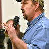 (Brad Davis/The Register-Herald) Minden resident Carl Moore, a U.S. Army veteran who himself endured a bout with cancer after returning home, asks questions of officials on hand during the comment portion of a public meeting between town residents and representatives from state and federal agencies tasked with investigating the presence of PCB's there Friday night at New Beginning Apostolic Church.