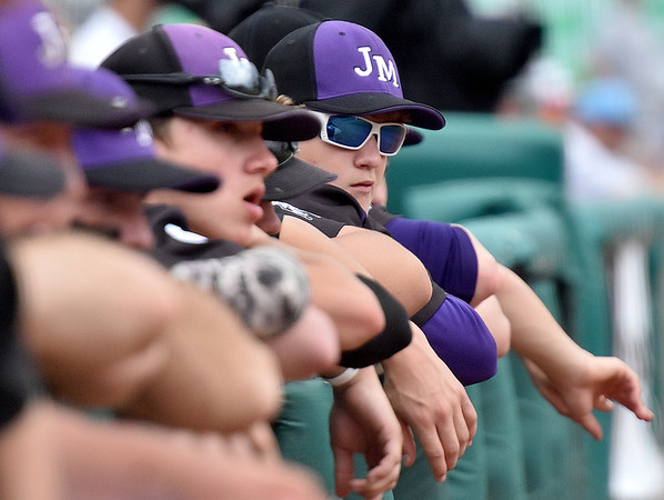 (Brad Davis/The Register-Herald) James Monroe players look on from the dugout during their game the Bridgeport Indians Indians Friday afternoon at Appalachian Power Park in Charleston.