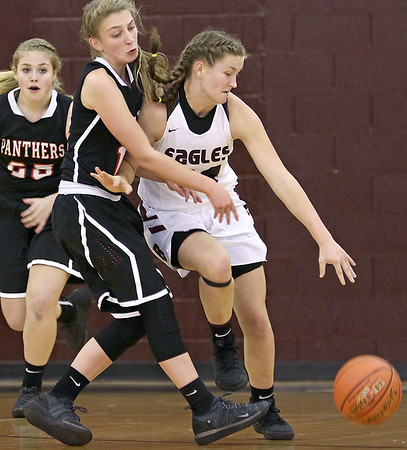 (Brad Davis/The Register-Herald) Woodrow Wilson's Liz Cadle shields the ball from PikeView's  Hannah Perdue as she moves up the court Thursdsay night in Beckley.