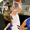 (Brad Davis/The Register-Herald) Woodrow Wilson's Elizabeth Cadle shoots against Morgantown during Big Atlantic Classic action Thursday night at the Beckley-Raleigh County Convention Center.