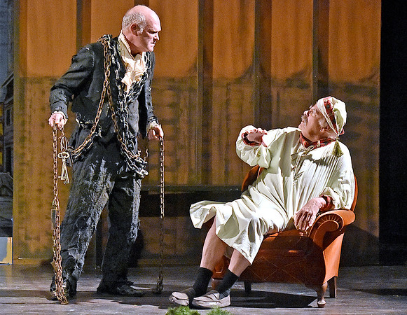 (Brad Davis/The Register-Herald) Scrooge, played by Gene Worthington, is visited by one of a few ghosts that will haunt him during Treehouse Arts Ensemble's production of A Christmas Carol, which opens tonight at Tamarack.