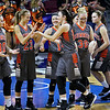 (Brad Davis/The Register-Herald) Summers County player Hannah Taylor and her Lady Bobcats teammates get fired up Friday night at the Charleston Civic Center.
