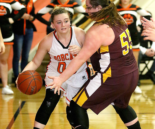 (Brad Davis/The Register-Herald) Summers County's Erica Merrill tries to get around Pocahontas County's Charity Warder Wednesday night in Hinton.