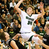 (Brad Davis/The Register-Herald) Wyoming East's Ethan England drives and scores through Westside defender Travis Cook Saturday night in New Richmond.