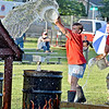 (Brad Davis/The Register-Herald) Firefighters from Hillsboro Volunteer Fire Department try to beat their opponents from Coal City FD in filling the barrell by tossing buckets full of water onto a small roof as fast as they can during the Alderson Fireman's Rodeo Friday evening, part of the town's annual 4th of July Celebration.