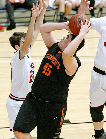 (Brad Davis/The Register-Herald) Summers County's Caleb Harvey drives to the basket as Greater Beckley Christian's Thaddaeus Jordan defends during the Crusaders' win over the Bobcats Friday night at the Beckley-Raleigh County Convention Center.