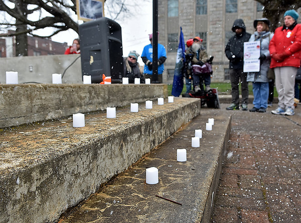 (Brad Davis/The Register-Herald) Candles representing recent mass shooting victims sit burning on the gazeebo stairs during Beckley's March For Our Lives rally Saturday afternoon at Shoemaker Square.