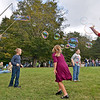 (Brad Davis/The Register-Herald) A hoard of children flock around Charles Garratt, full time photographer and part-time bubble man, as he streams massive strings of bubbles into the air for them to chase around during the 31st Annual Cranberry Shindig Sunday afternoon at the Cranberry Nature Center in Hillsboro.