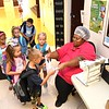 Sheryl Mitchell, cafetera manager Crescent Elementary School in Beckley, hands out breakfast to student during the first day of school in Raleigh County.<br /> (Rick Barbero/The Register-Herald)