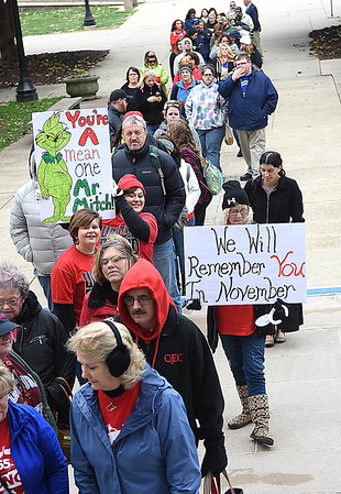Long line of teachers, service personnel and students, entering the State Capitol building in Charleston Friday moring preparing for a rally during the seventh day of their walkout. <br /> (Rick Barbero/The Register-Herald)