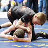 Beckley's Garrett Johnson pins Wheeling's Braxten Harbart during their wrestling match as part of the WVYWA State Tournament in Beckley Saturday. (Chris Jackson/The Register-Herald)