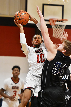 Greater Beckley Christian's Josiah Walton (10)  puts up a shot on basket over Valley's Jimmy Harper (34) during their basketball game Tuesday in Beckley. (Chris Jackson/The Register-Herald)