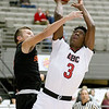 (Brad Davis/The Register-Herald) Greater Beckley Christian's Orlando Potter drives and scores as Summers County's Samuel Wykle defends during the Crusaders' win over the Bobcats Friday night at the Beckley-Raleigh County Convention Center.