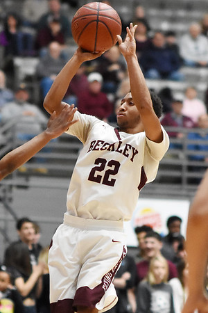 Woodrow's Josiah Walton (22) hits a jumper during the second quarter of their basketball sectional championship against Capital Tuesday in Beckley. (Chris Jackson/The Register-Herald)