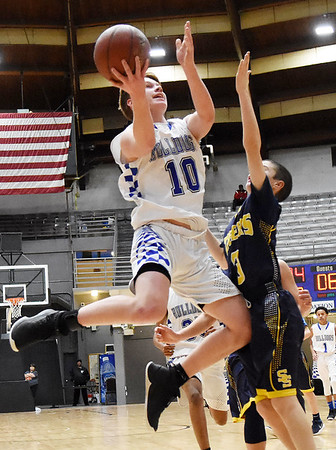 Beckley-Stratton's Maddox McMillen (10) puts a layup over Shady Spring's Cole Chapman (3) during their Big Atlantic Classic basketball game in Beckley Monday. (Chris Jackson/The Register-Herald)