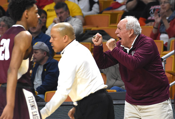Woodrow Wilson asst. coach Dave Barksdale working the sideline during game against Martinsburg in the quarter-final game of the Class AAA Boys State Basketball Tournament held at the Charleston Civic Center. Martingburg won 58-48<br /> (Rick Barbero/The Register-Herald)