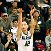 (Brad Davis/The Register-Herald) Wyoming East's R.J. Hood shoots from three-point range Saturday night in New Richmond.
