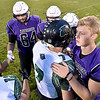 (Brad Davis/The Register-Herald) Wyoming East and James Monroe players greet one another prior to the coin toss Friday night in Lindside.