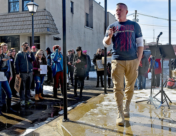 """(Brad Davis/The Register-Herald) State Senator Richard Ojeda speaks during the """"It's Our Time"""" rally marking the one-year anniversary of the Women's March Saturday morning in Beckley's Showmaker Square."""