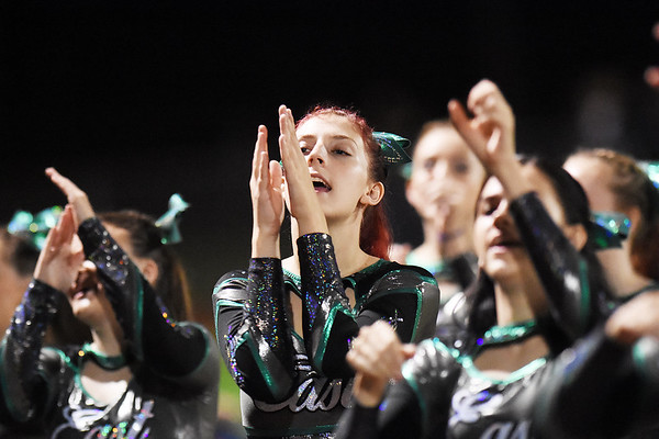 Wyoming East's cheerleaders perform during their high school football game against Shady Spring Friday in Shady Spring. (Chris Jackson/The Register-Herald)