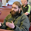 (Brad Davis/The Register-Herald) Oak Hill resident Brandon Richardson voices concerns and asks questions of representatives from state and federal agencies on hand during the second day of public meetings on progress in the investigation of PCB's in the town Saturday morning at New Beginnings Apostolic Church.
