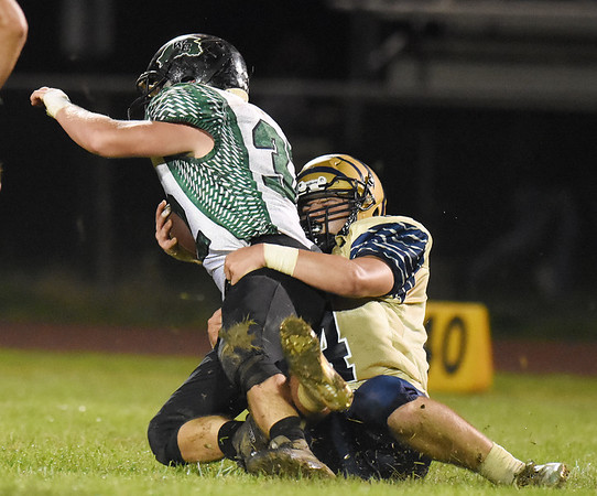 Shady Spring's Dane Chapman (84) tackles Wyoming East's Michael Elkins (32) during their high school football game Friday in Shady Spring. (Chris Jackson/The Register-Herald)