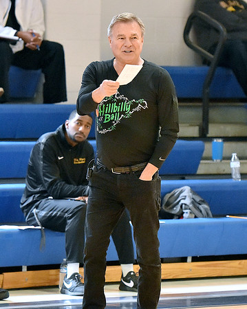 (Brad Davis/The Register-Herald) Attending coaches from area high schools and colleges pay attention and take notes as Marshall men's basketball head coach and Mullens native Dan D'Antoni speaks during this year's WVU Tech Coaches clinic Sunday morning in the Van Meter Gymnasium.