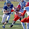 (Brad Davis/The Register-Herald) Nicholas County's Jacob O'Dell avoids a tackle from Weir defender Tyler Komorowski Saturday afternoon in Summersville.