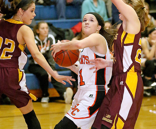(Brad Davis/The Register-Herald) Summers County's Taylor Isaac drives to the basket as Pocahontas County's Laila Calhoun, left, Kira Bircher defend Wednesday night in Hinton.