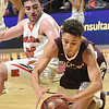 Cedric Bush, of Martinsburg, left, fights for a loose ball against Eddie Christian, of Beckley, during the quarter-final game of the Class Aa Boys State Basketball Tournament held at the Charleston Civic Center. Martinsburg won 58-48<br /> (Rick Barbero/The Register-Herald)