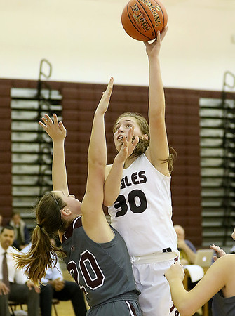 (Brad Davis/The Register-Herald) Woodrow Wilson's Laken Ball turns and scores in the paint as George Washington's Mary-Lyle Smith defends Thursday night in Beckley.