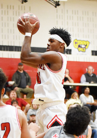 Oak Hill's Andrew Work (23) grabs an offensive rebound during the second quarter of their high school basketball game against Cabell Midland Tuesday in Oak Hill. (Chris Jackson/The Register-Herald)