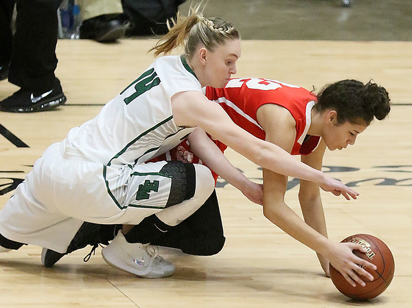 (Brad Davis/The Register-Herald) Wyoming East's Jazz Blankenship and Parkersburg's Shaylee Kirby dive for a loose ball during Big Atlantic Classic action Wednesday night at the Beckley-Raleigh County Convention Center.