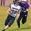 (Brad Davis/The Register-Herald) Wyoming East's Caleb Bower carries the ball against James Monroe Friday night in Lindside.