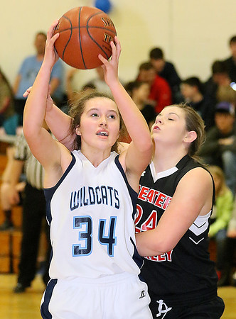(Brad Davis/The Register-Herald) Meadow Bridge's Shauna Harless drives to the basket as Greater Beckley Christian's Brooke Daniels defends Thursday night in Meadow Bridge.