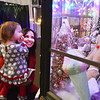 Lisa Massey, from Daniels, looks ta a display with her granddaughter, Maya, 2, during the Santa Christmas Adventure at The Resort at Glade Springs on Saturday. (Chris Jackson/The Register-Herald)