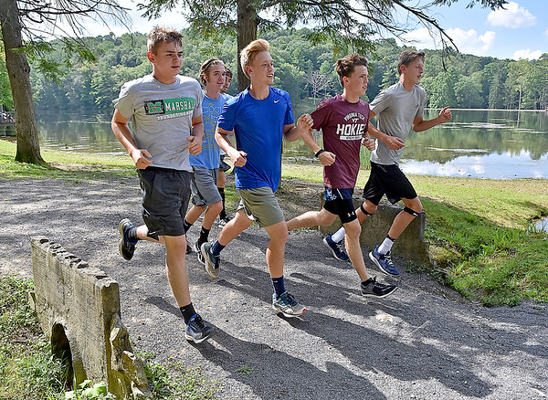 (Brad Davis/The Register-Herald) Members of the Shady Spring cross country team trek around Little Beaver Park during a practice Wednesday afternoon.