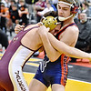 (Brad Davis/The Register-Herald) Independence's Sean Dawson takes on Williamstown's Colton Slagel in a 120-pound weight class matchup during state wrestling tournament action Thursday night at Huntington's Big Sandy Arena. Indy's Dawson won the match.