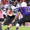 (Brad Davis/The Register-Herald) Wyoming East's Michael Elkins carries the ball Friday night in Lindside.