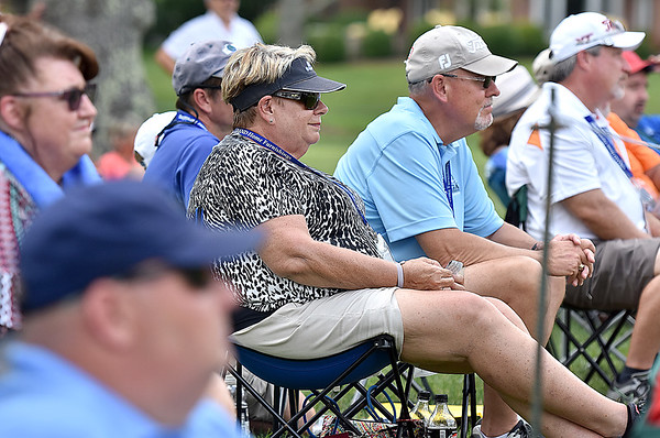 (Brad Davis/The Register-Herald) Fans watch from a shady area around the no. 8 green during opening round action of the Military Tribute at The Greenbrier Thursday afternoon in White Sulphur Springs.