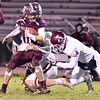 (Brad Davis/The Register-Herald) Woodrow Wilson's Logan Cook carries the ball as George Washington defender Gary Smith III tries to tackle him Friday night in Beckley.